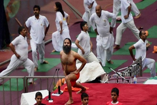 PM leads yoga day amid rain