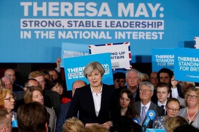 Defiant May vows to lead Britain to Brexit after UK election blow