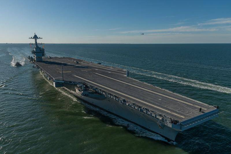 Jim Harbaugh Attends Christening Of The USS Gerald Ford